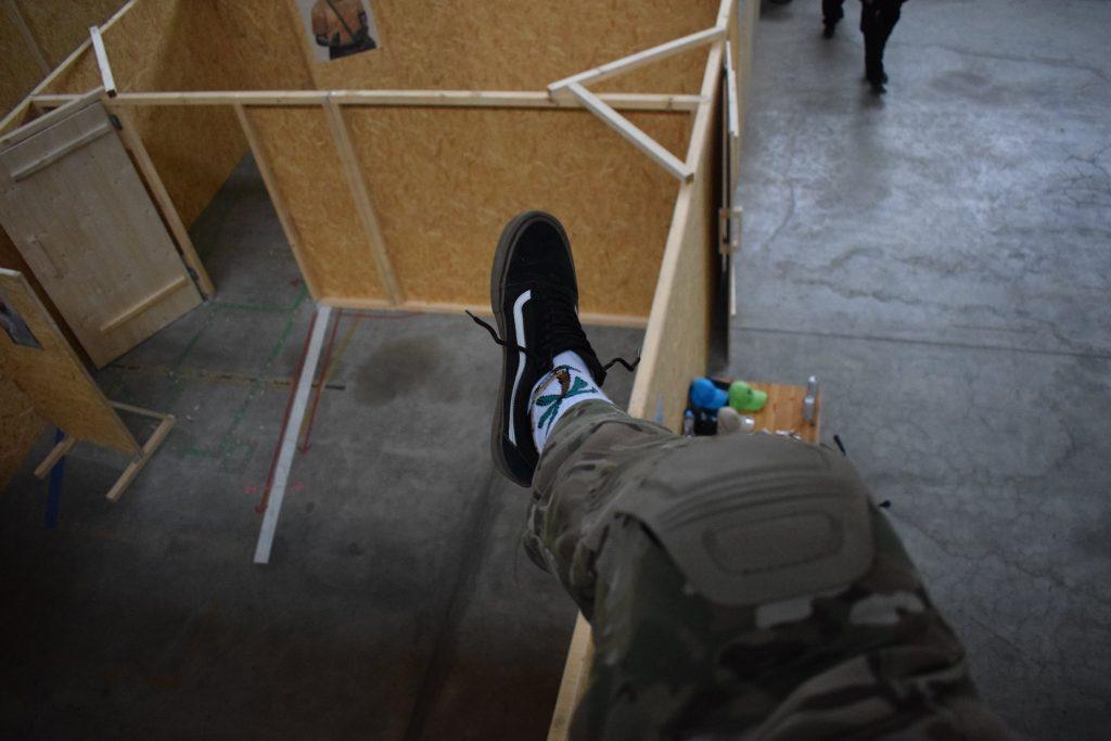 Tactical Skater VANS with strange ugly Socks in a CQB Area
